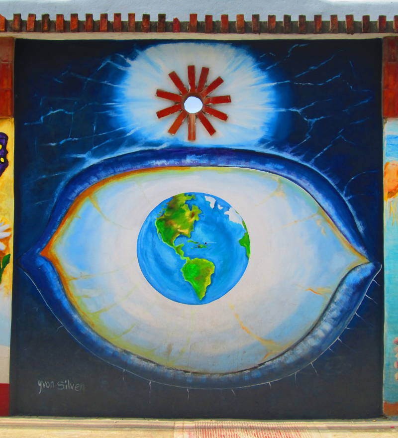 An eye with a globe of the world as its iris